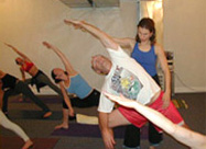 Laurel Hodory giving personalized yoga instruction