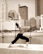 yoga in front of a city backdrop